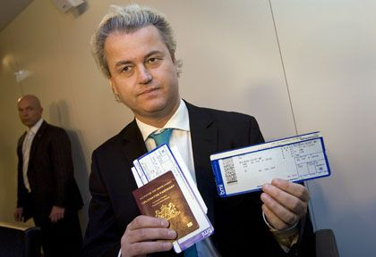 Far-right Dutch politician Geert Wilders shows his passport and boarding pass at Amsterdam's Schiphol airport before leaving for London on Thursday.