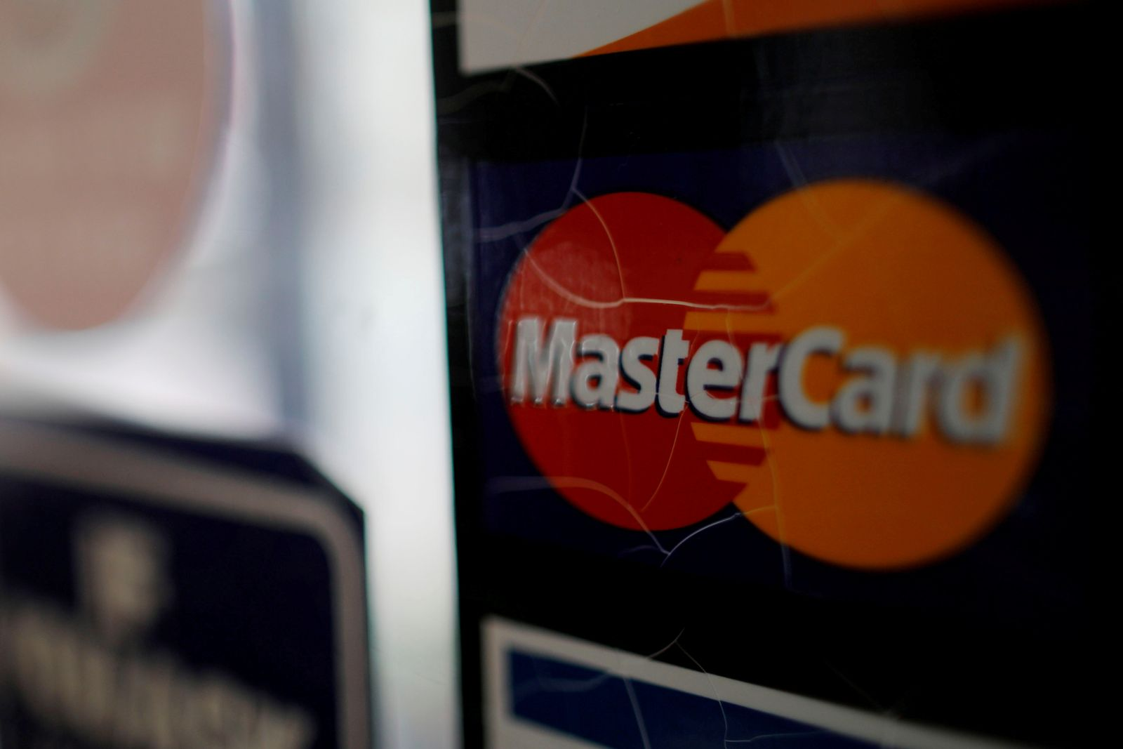 FILE PHOTO: A sticker shows that a store accepts MasterCard in Harvard Square in Cambridge