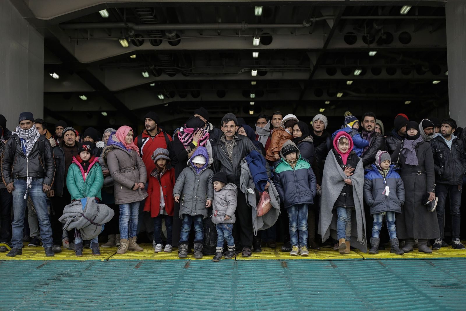 Refugees and migrants arrive at Piraeus port