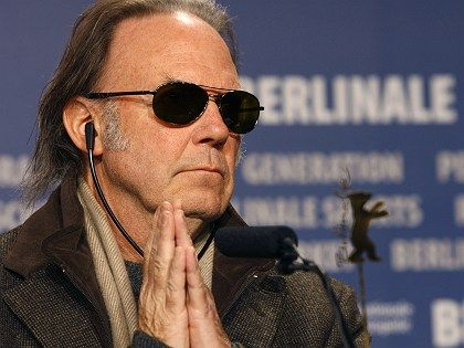 Canadian singer-songwriter Neil Young told reporters gathered at the Berlin International Film Festival that music cannot save the world.