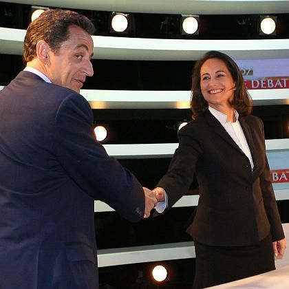 The two candidates shaking hands before Wednesday's TV debate. France is deciding between two very different visions of France's future.