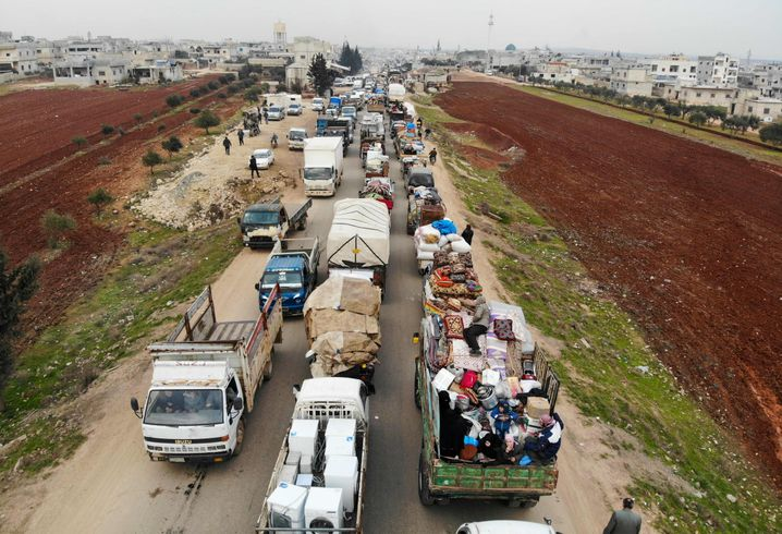 Displaced Syrians drive through the northern countryside in Idlib province.