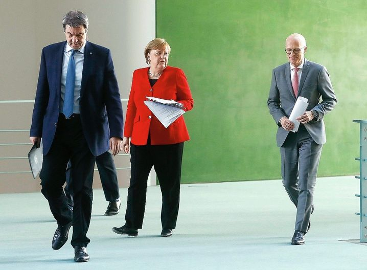 Chancellor Angela Merkel, together with Bavarian Governor Markus Söder and Hamburg Mayor Peter Tschentscher after a May 6 video conference on easing the coronavirus lockdown restrictions.