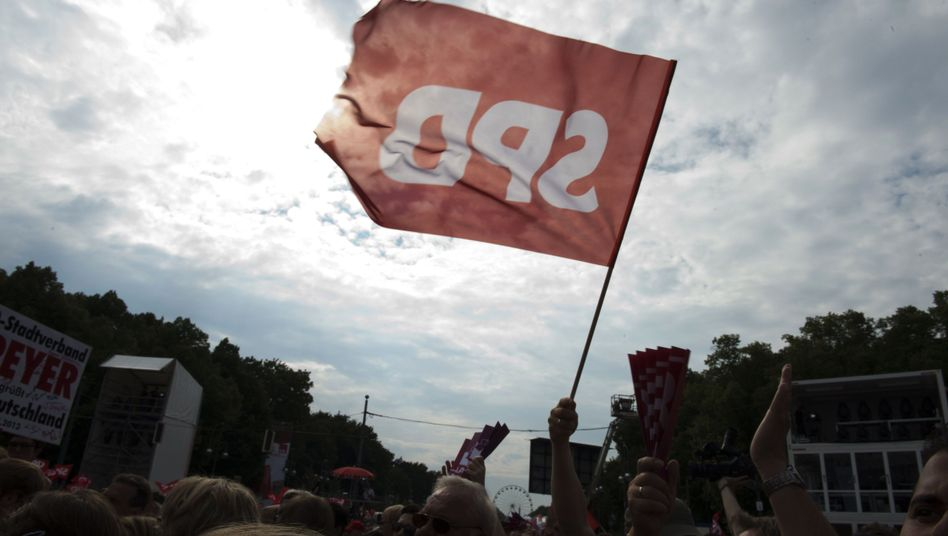 One of the SPD's dwindling supporters waves a party flag earlier this month at a rally in Berlin.