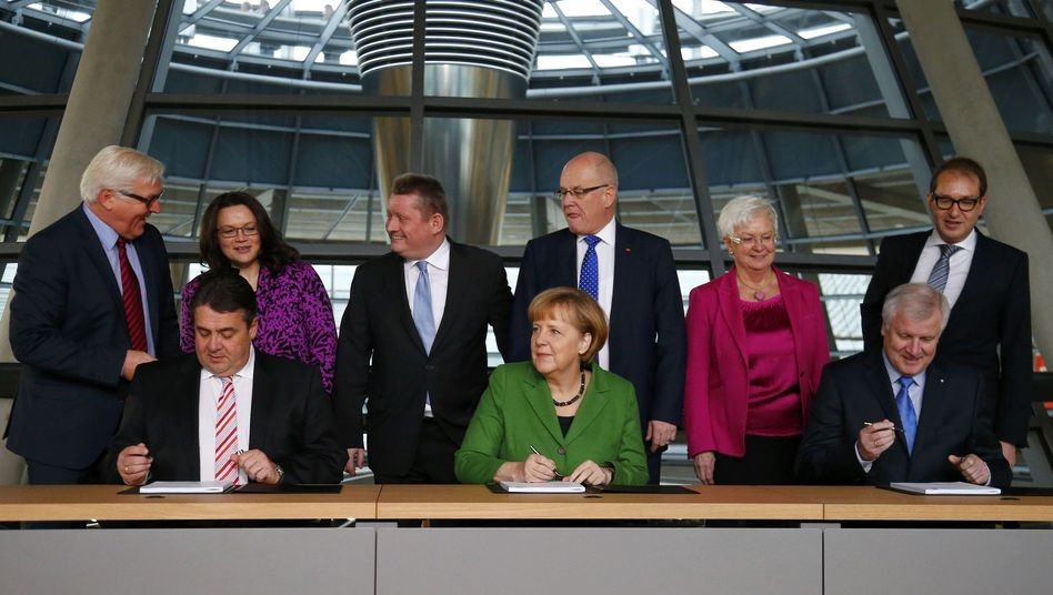 Almost a done deal: Chancellor Angela Merkel (center) is flanked by the heads of the two parties with whom she plans to govern.