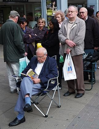 Customers wait in a queue outside a branch of Northern Rock, the British mortage lender, in London in September.