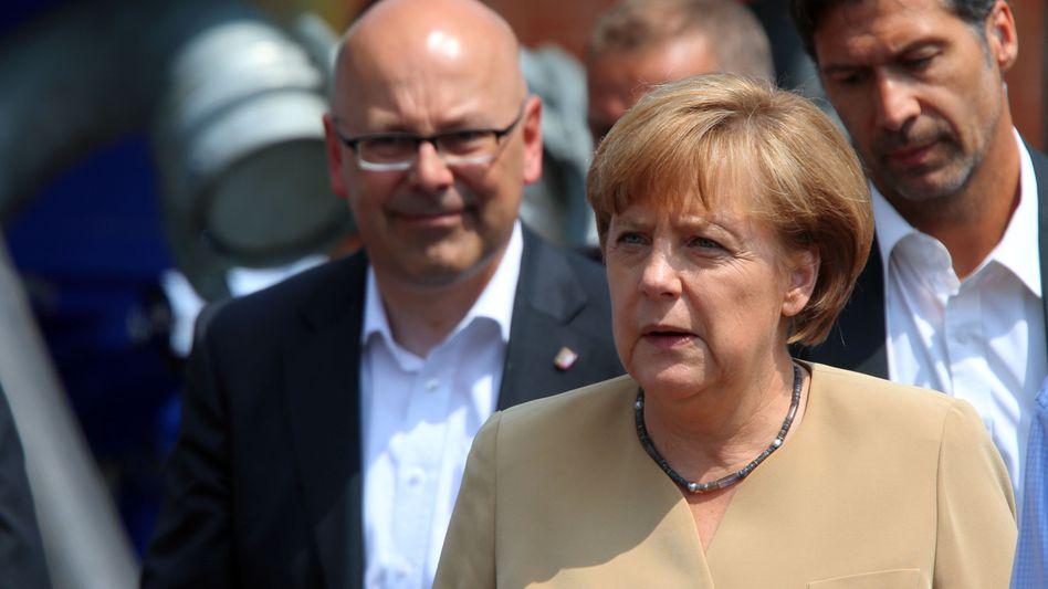 """Schleswig-Holsteins Ministerpräsident Torsten Albig (l.): """"Merkel macht das ausgezeichnet"""""""