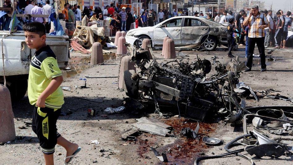 Trümmerteile im Stadtteil Sadr City in Bagdad: Welle der Gewalt im Irak