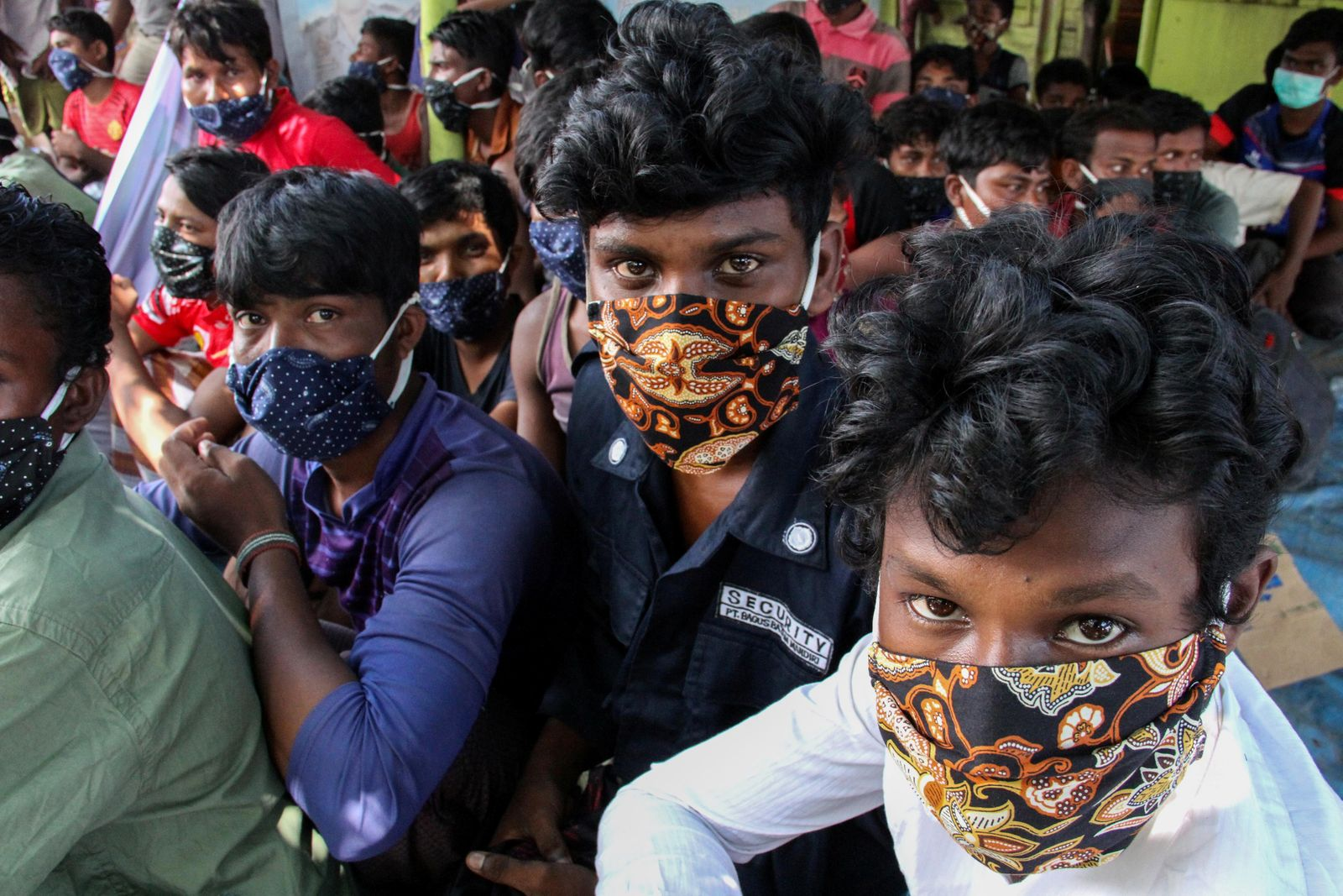 Rohingya refugees wearing protective face masks are pictured in Lhokseumawe