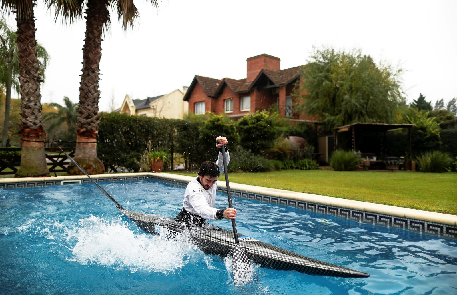 Argentine canoeist Sebastian Rossi trains in his girlfriend's pool, due to the coronavirus disease (COVID-19) outbreak, as he prepares for the postponed Tokyo 2020 Olympic Games, in Buenos Aires