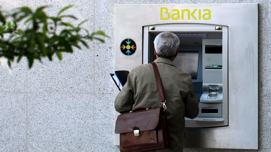 Nearly 10 percent of Spanish savings are held at Bankia, which the government in Madrid nationalized this week.