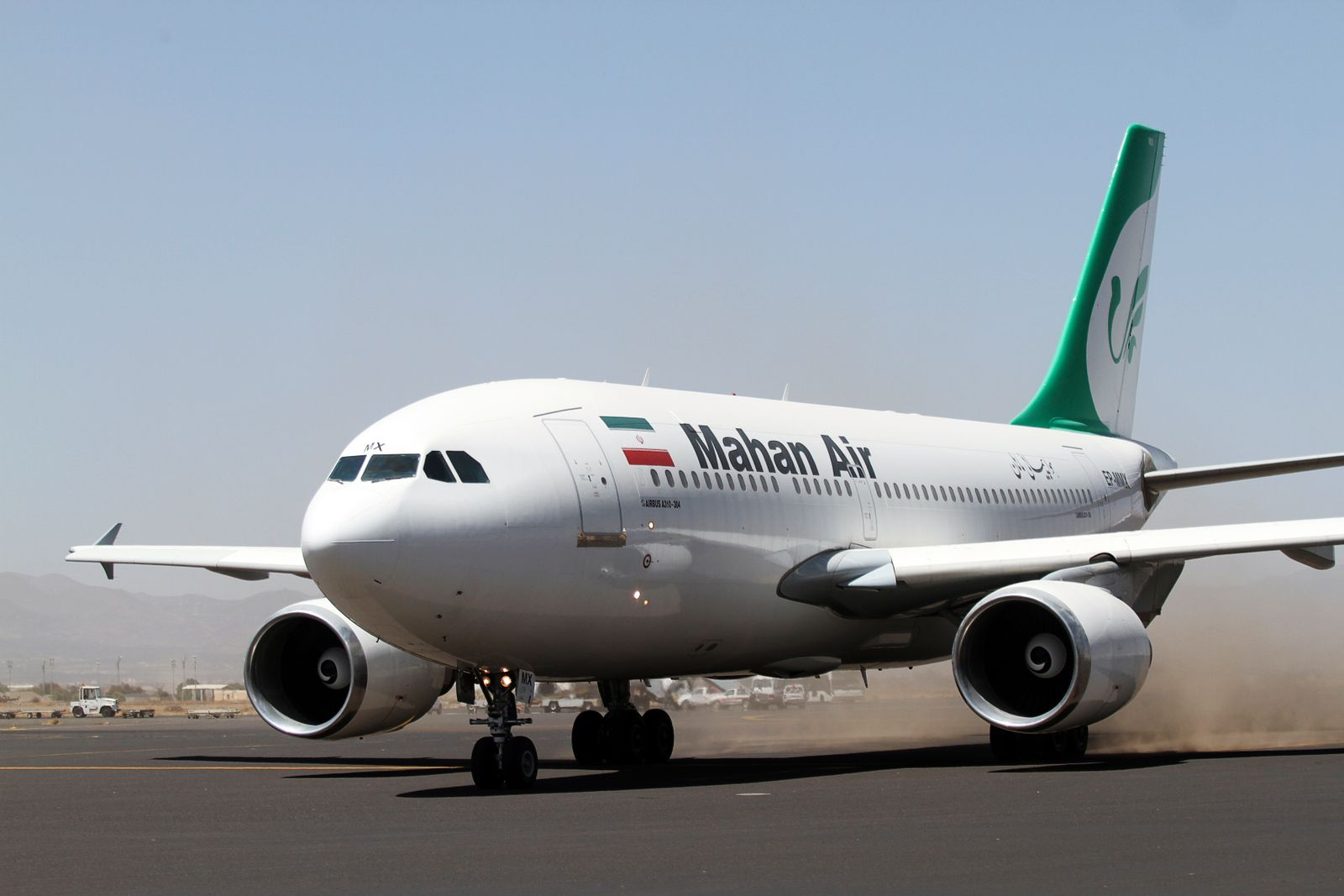 An Airbus A310 of Iranian private airline Mahan Air taxis at Sanaa International airport following its first flight to Yemen from Iran, in Sanaa
