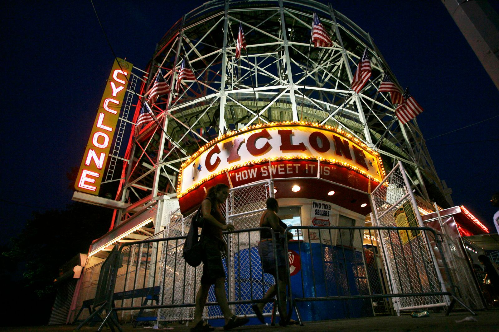 People line up to ride the Cyclone at the Astroland Amusement park in the Coney Island neighborhood of New York