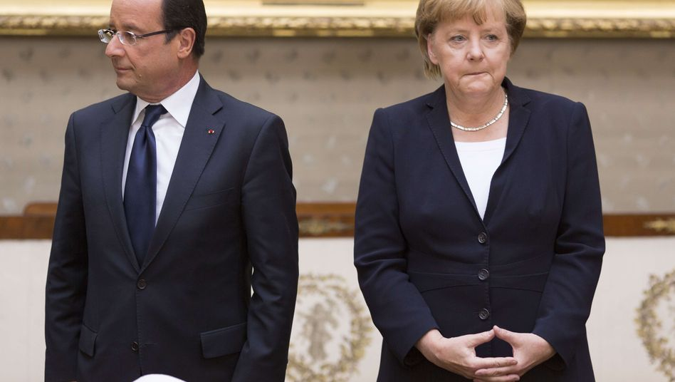 François Hollande and German Chancellor Angela Merkel: A year into Hollande's term, Franco-German relations are even worse than pessimists in both countries had predicted.