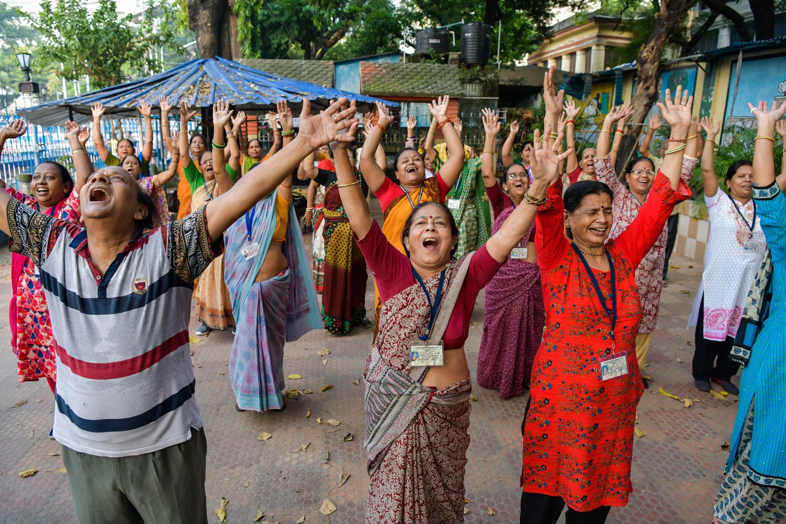 Senior People enjoy laughter yoga session at college square
