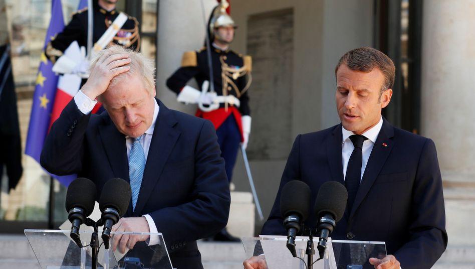 Kein gutes Verhältnis zwischen Boris Johnson (links) und Emmanuel Macron: Ein harter Brexit scheint immer wahrscheinlicher