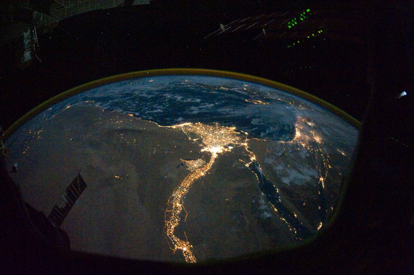 A night time photograph made by an International Space Station Expedition 25 crewmember shows the bright lights of Cairo and Alexandria, Egypt.