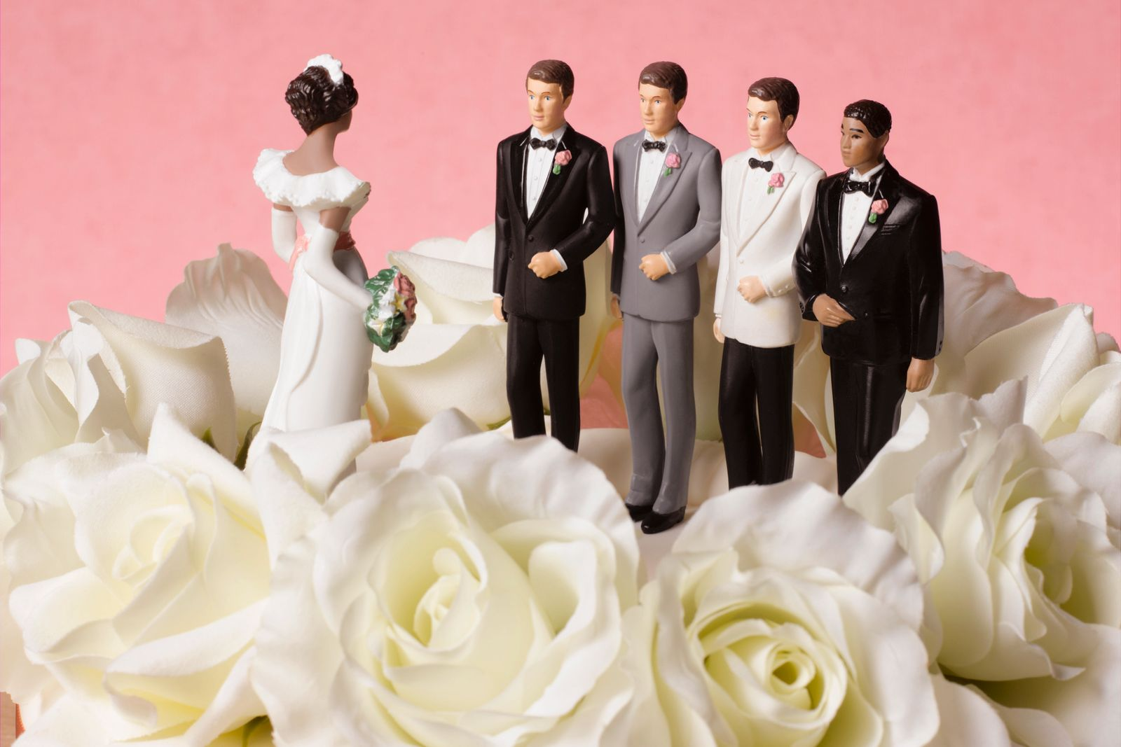 Bride figure on wedding cake with a choice of four grooms