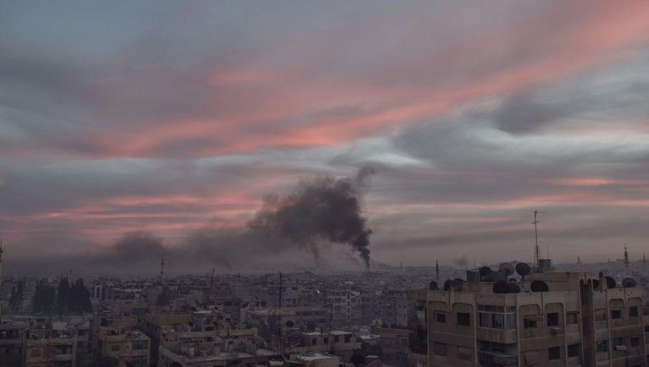 Smoke rises from Douma just north of Damascus.