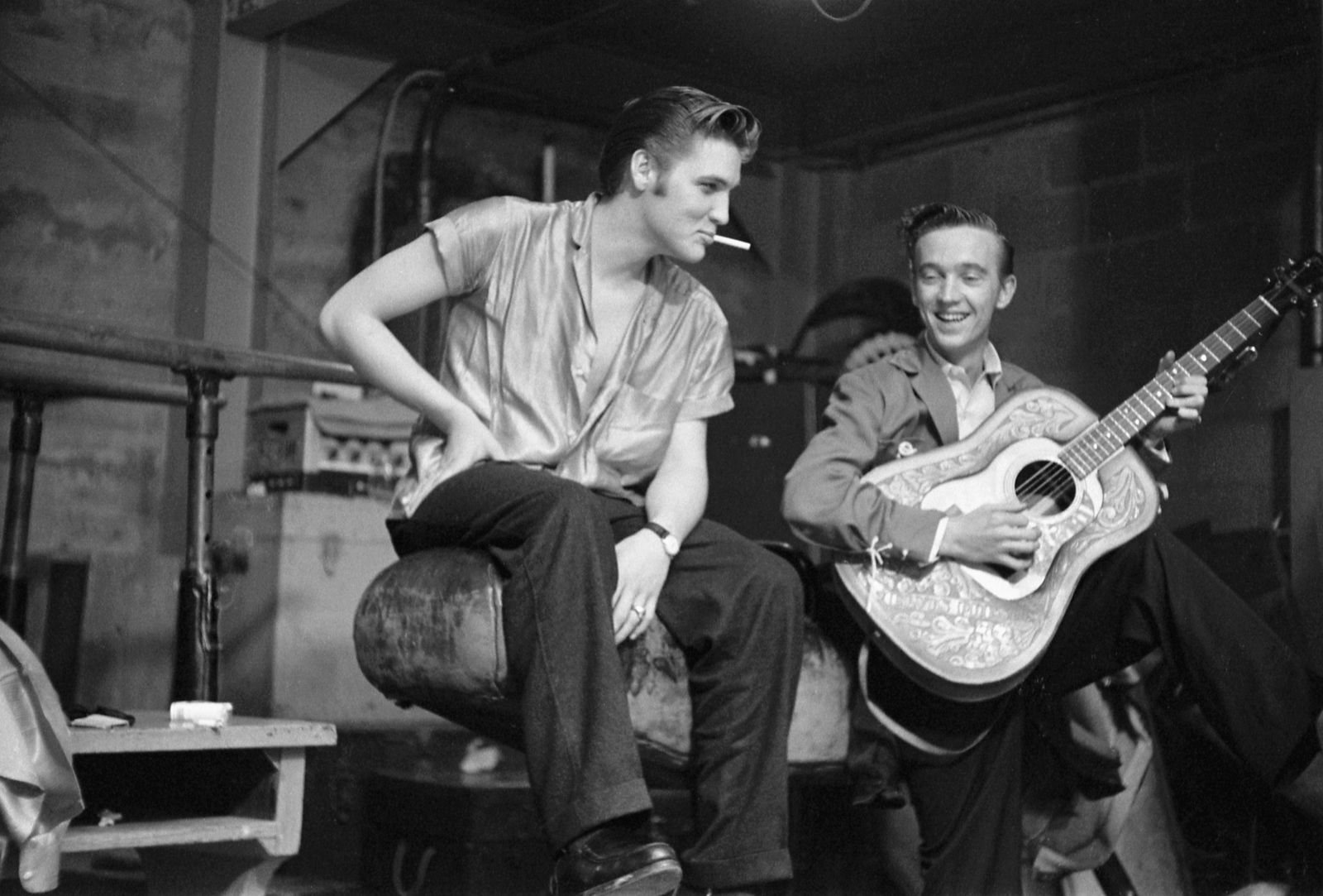 Elvis Presley and his cousin Gene Smith, backstage at the University of Dayton Fieldhouse, May 27, 1956. Gene Smith was part of Presley?s entourage, and is considered a member of the ?Memphis Mafia?.