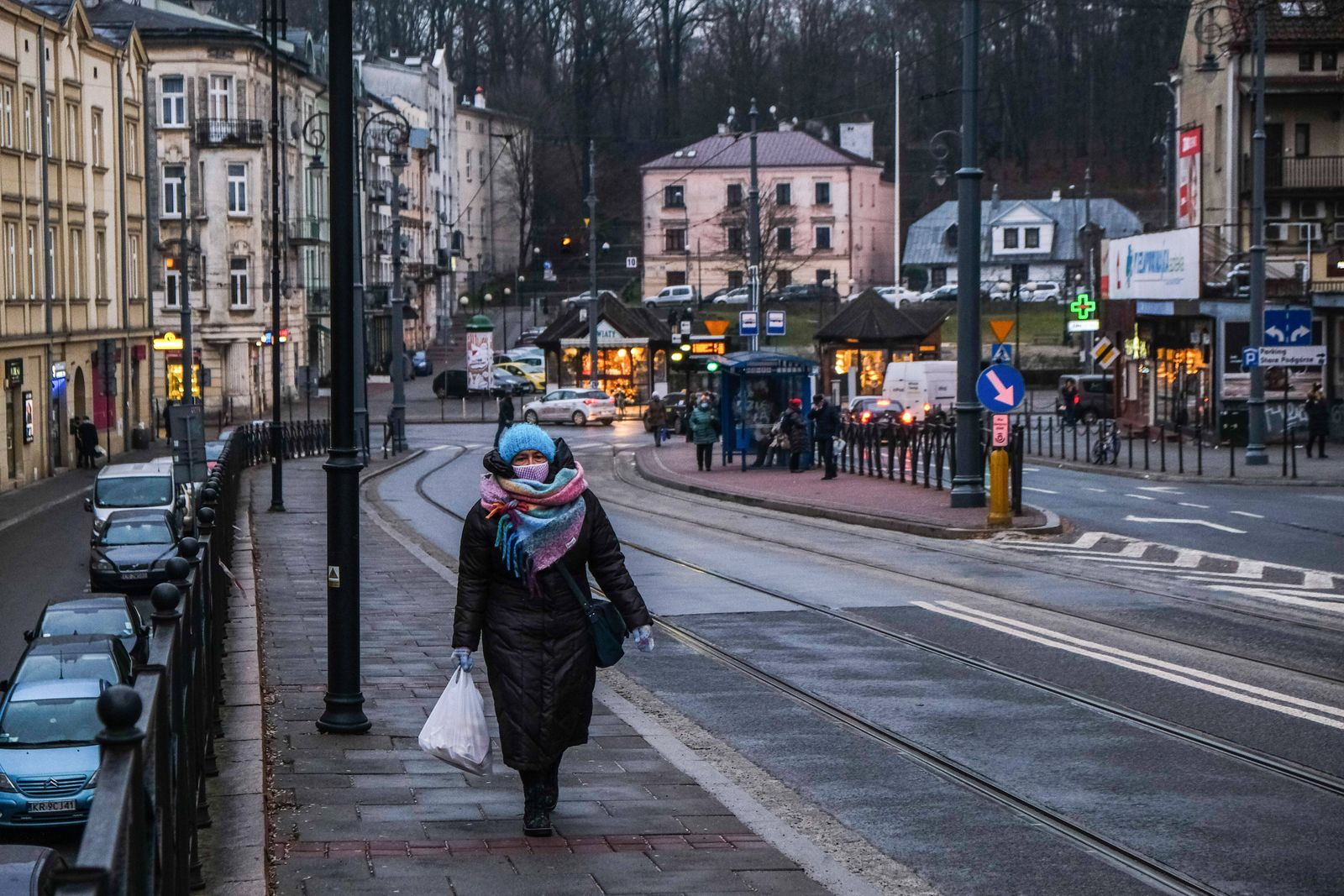 January 7, 2021, Krakow, Poland: A woman wearing a mask as a preventive measure against the spread of covid-19 walks alo