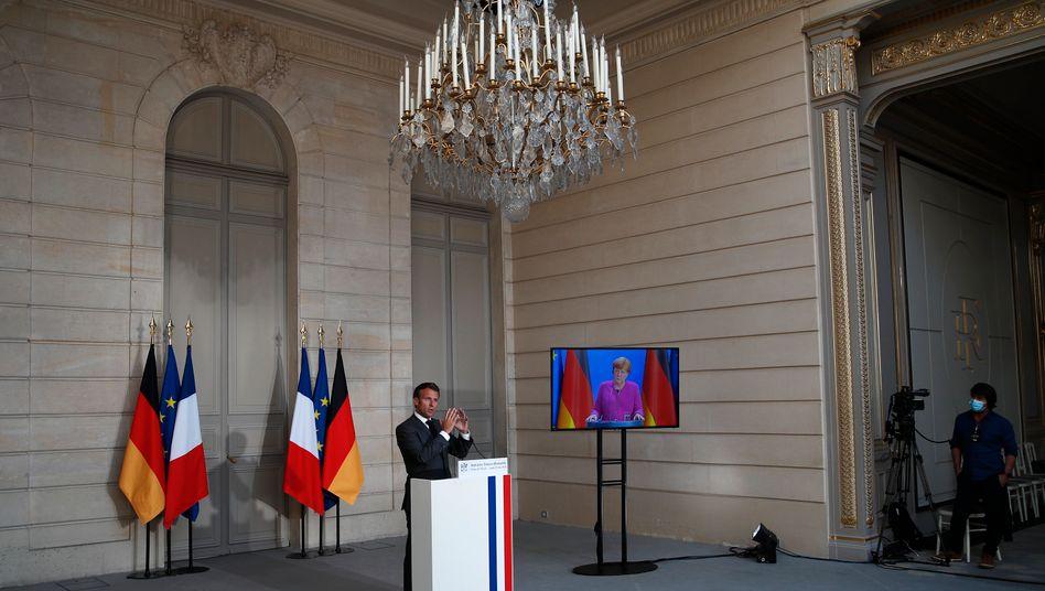 Staatspräsident Macron, Kanzlerin Merkel während einer Videopressekonferenz
