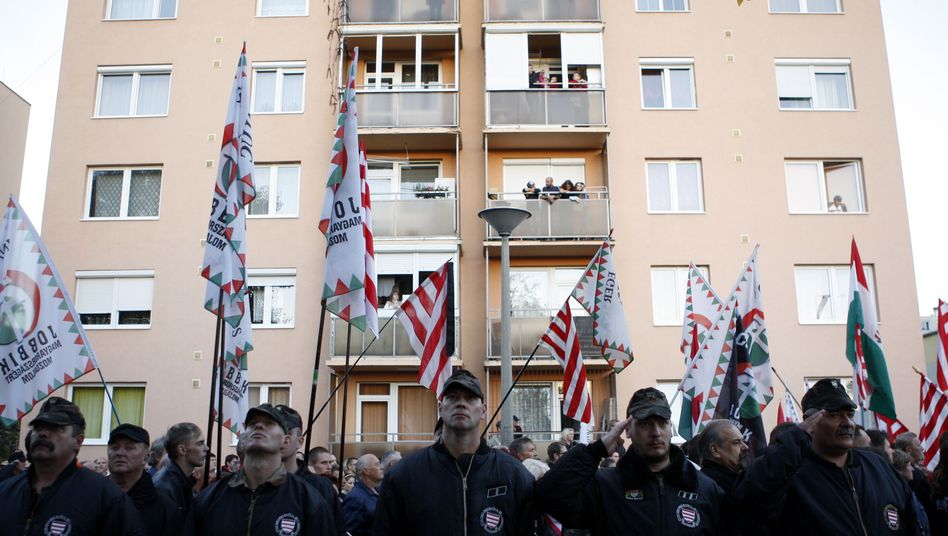 Supporters of the Hungarian far-right extremist Jobbik party take part in a demonstration in October at an apartment complex housing many Roma families in Miskolc, Hungary.