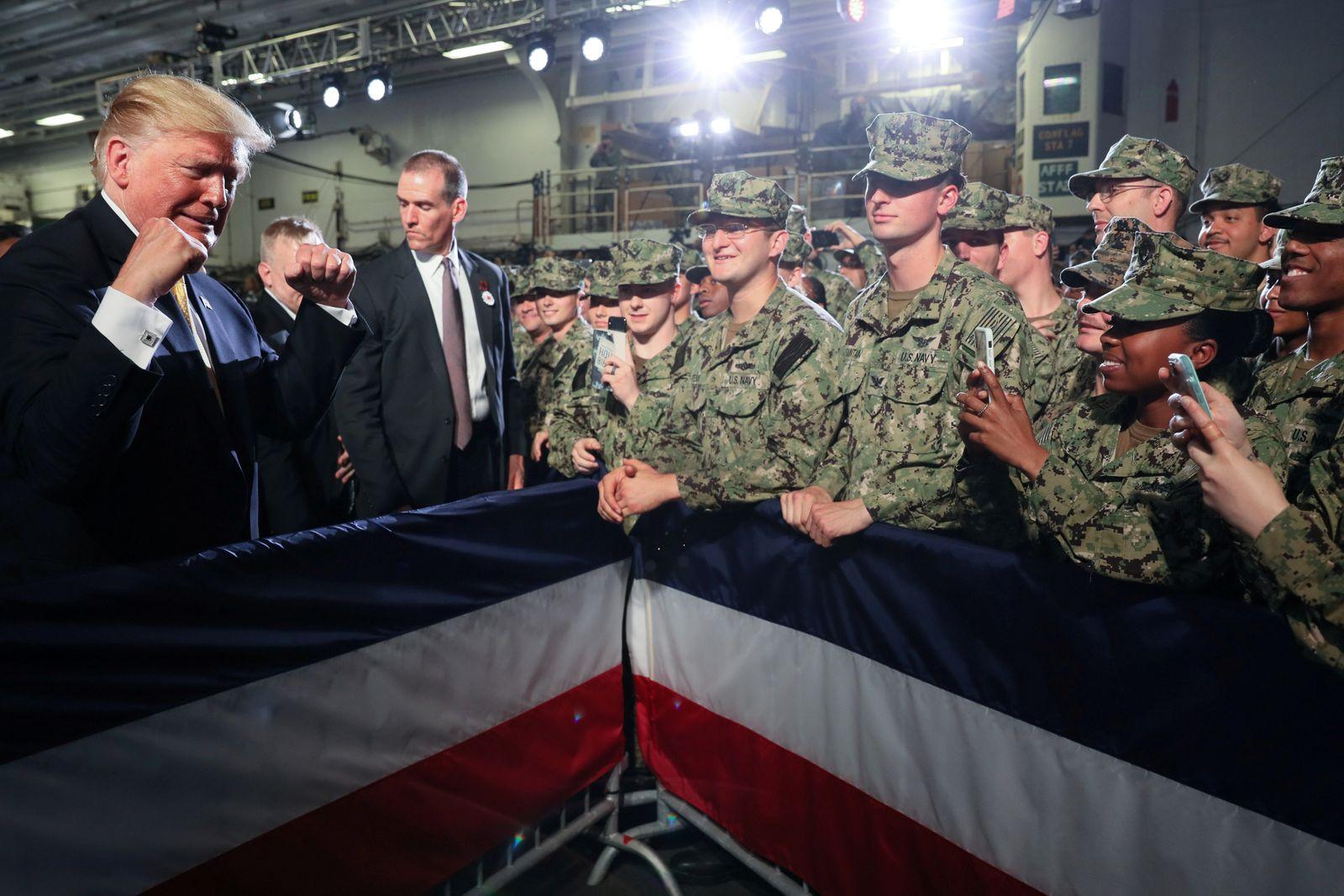 U.S. troops take photos of U.S. President Trump aboard the USS Wasp in Yokosuka