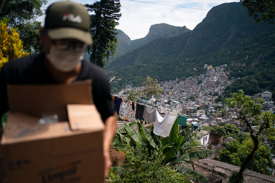 A volunteer carries soap and laundry detergent to the Rochinha favela.