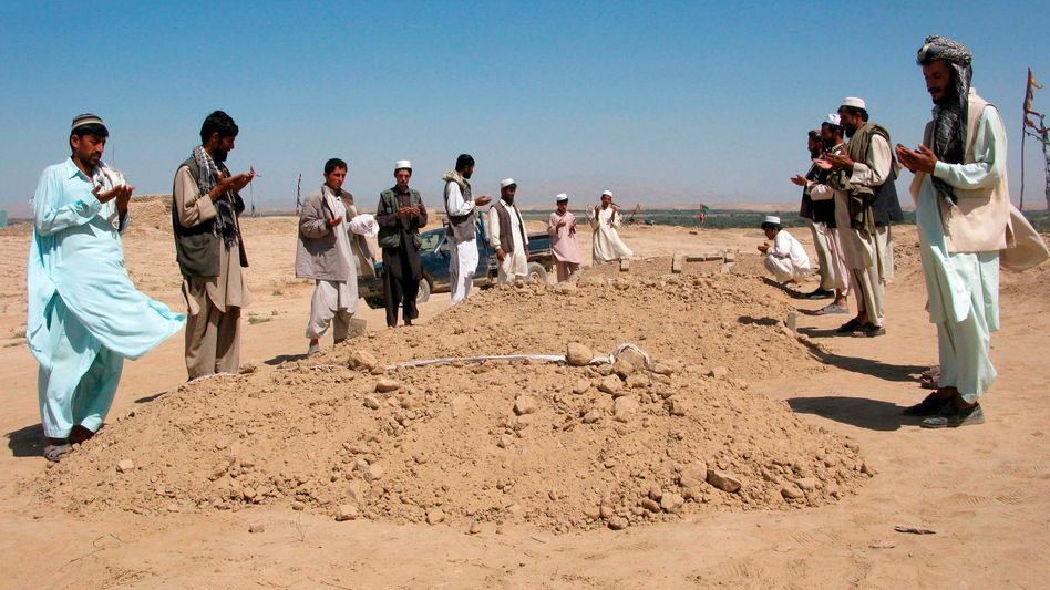 Afghan villagers laying to rest some of those who died in the Sept. 4 air strike near Kunduz.