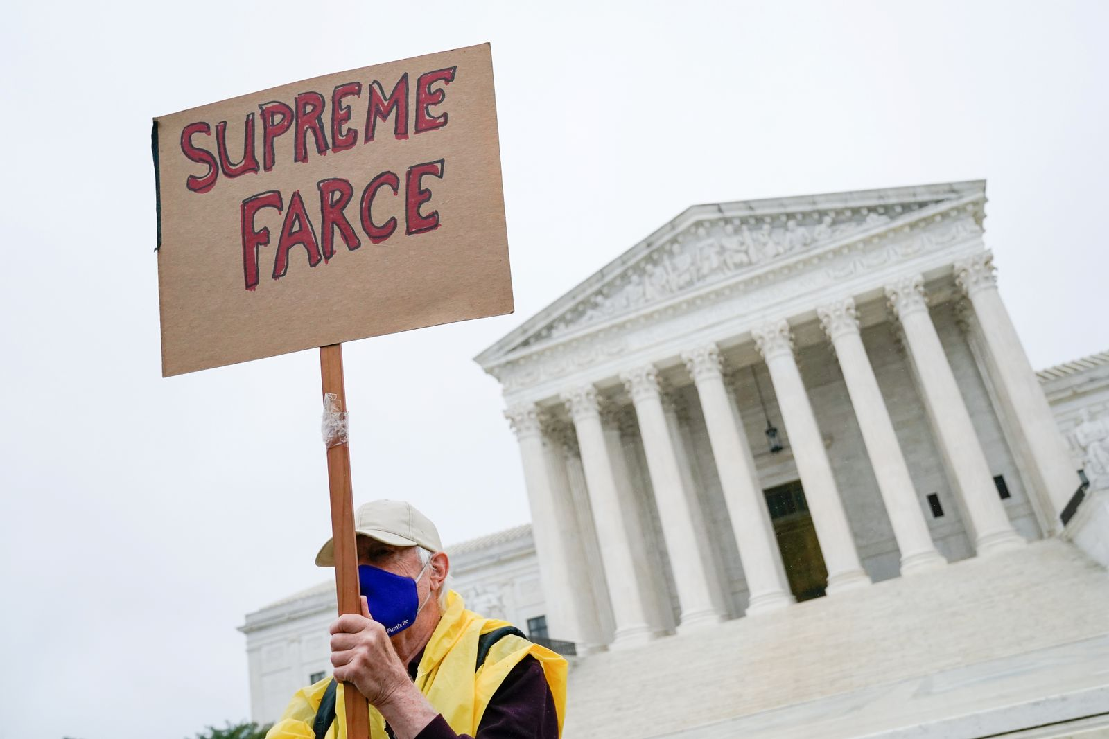 A protester against the Supreme Court nomination of Judge Amy Coney Barrett demonstrates outside the U.S. Supreme Court in Washington