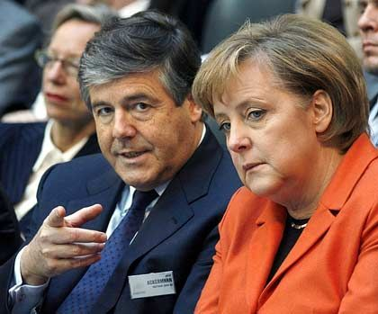 Deutsche Bank CEO Josef Ackermann and German Chancellor Angela Merkel.