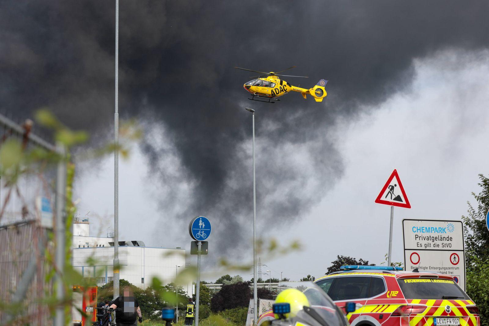 (210727) -- LEVERKUSEN (GERMANY), July 27, 2021 -- Smoke rises from the explosion site at Chempark Leverkusen in Leverku