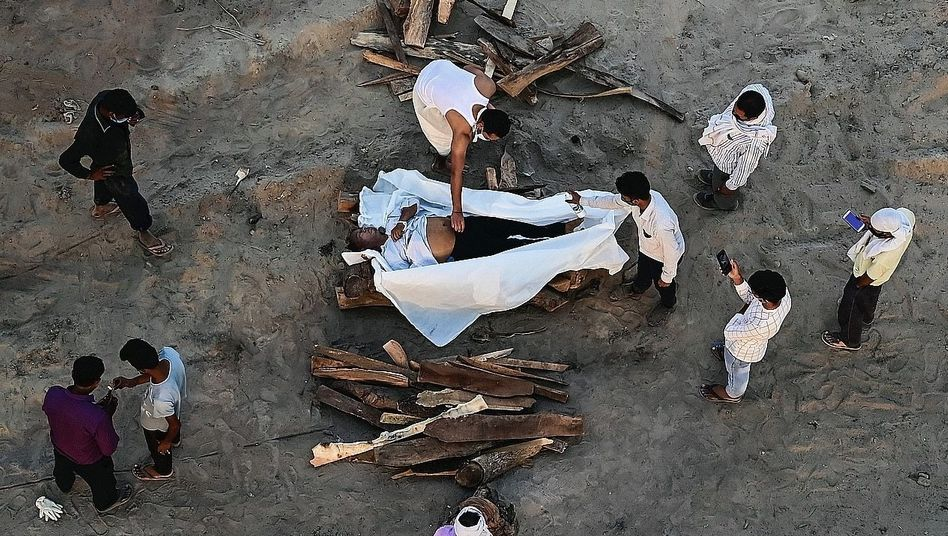 The cremation of a COVID-19 victim in Allahabad