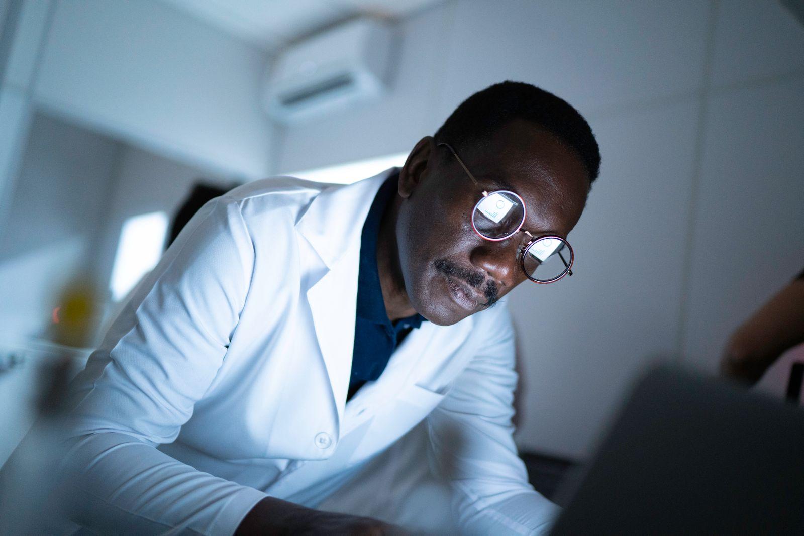 Scientist using computer in laboratory