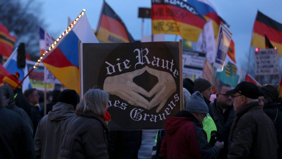 An anti-Merkel sign at a Pegida demonstration in March
