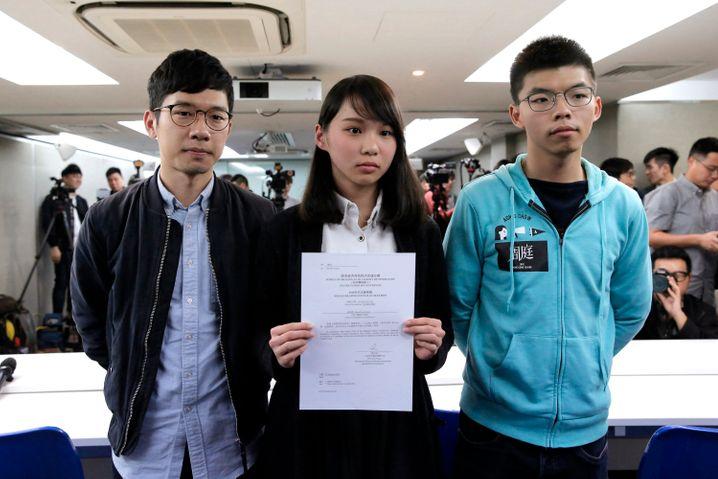 Nathan Law, Agnes Chow und Joshua Wong (v.l.n.r.) im Januar 2018