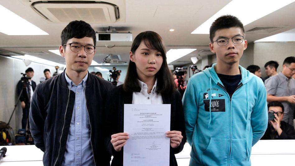 Demokratie-Aktivisten Nathan Law, Agnes Chow und Joshua Wong (Archivbild)
