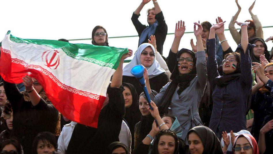 Iranian women cheer during a women's soccer match in Tehran in 2006.