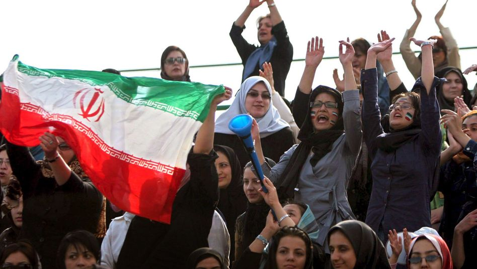 Iranian women cheer during a women's soccer match in Tehran in 2006.