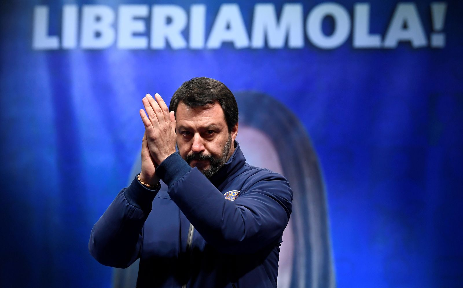 Leader of Italy's far-right League party Matteo Salvini applauds on stage during a rally ahead of a regional election in Emilia-Romagna, in Ravenna