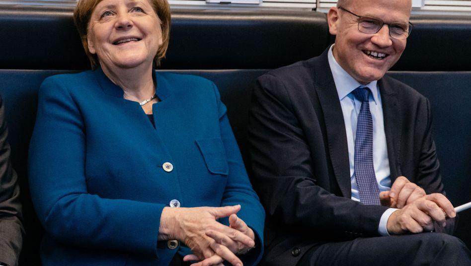 """Kanzlerin Merkel, Fraktionschef Brinkhaus: """"Den Kompromiss jetzt in unsere eigene Erzählung einbetten"""""""