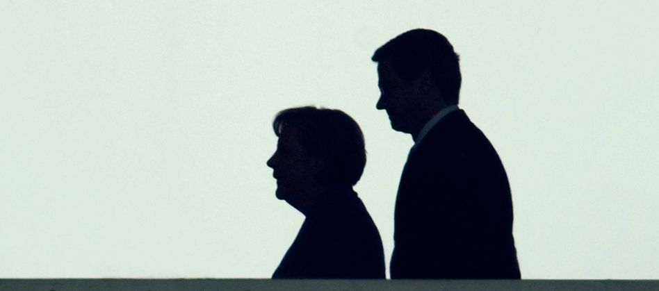 Angela Merkel and FDP leader Guido Westerwelle are seen in silhouette in the Chancellory on Sept. 28, as they met for preliminary talks on the day after the general election.
