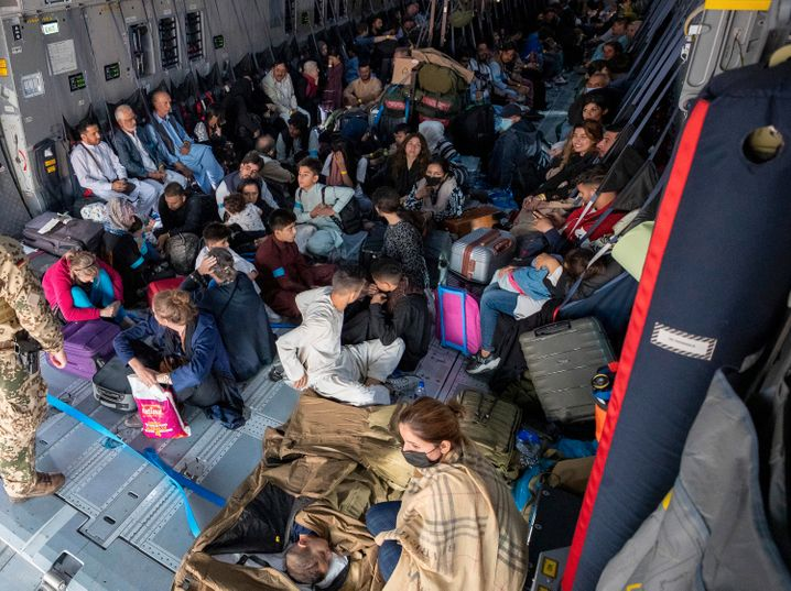 A group of evacuees in a German military plane at the Kabul airport on August 17.