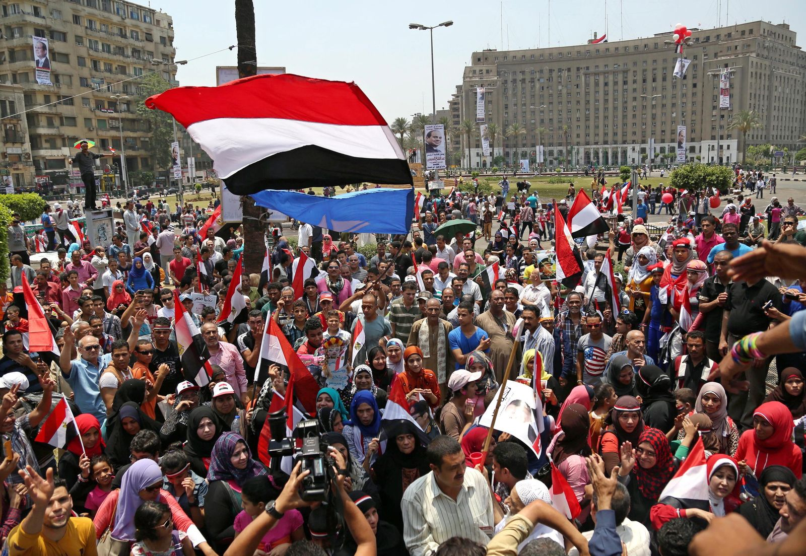Egyptians celebrate after the inauguration of President al-Sissi
