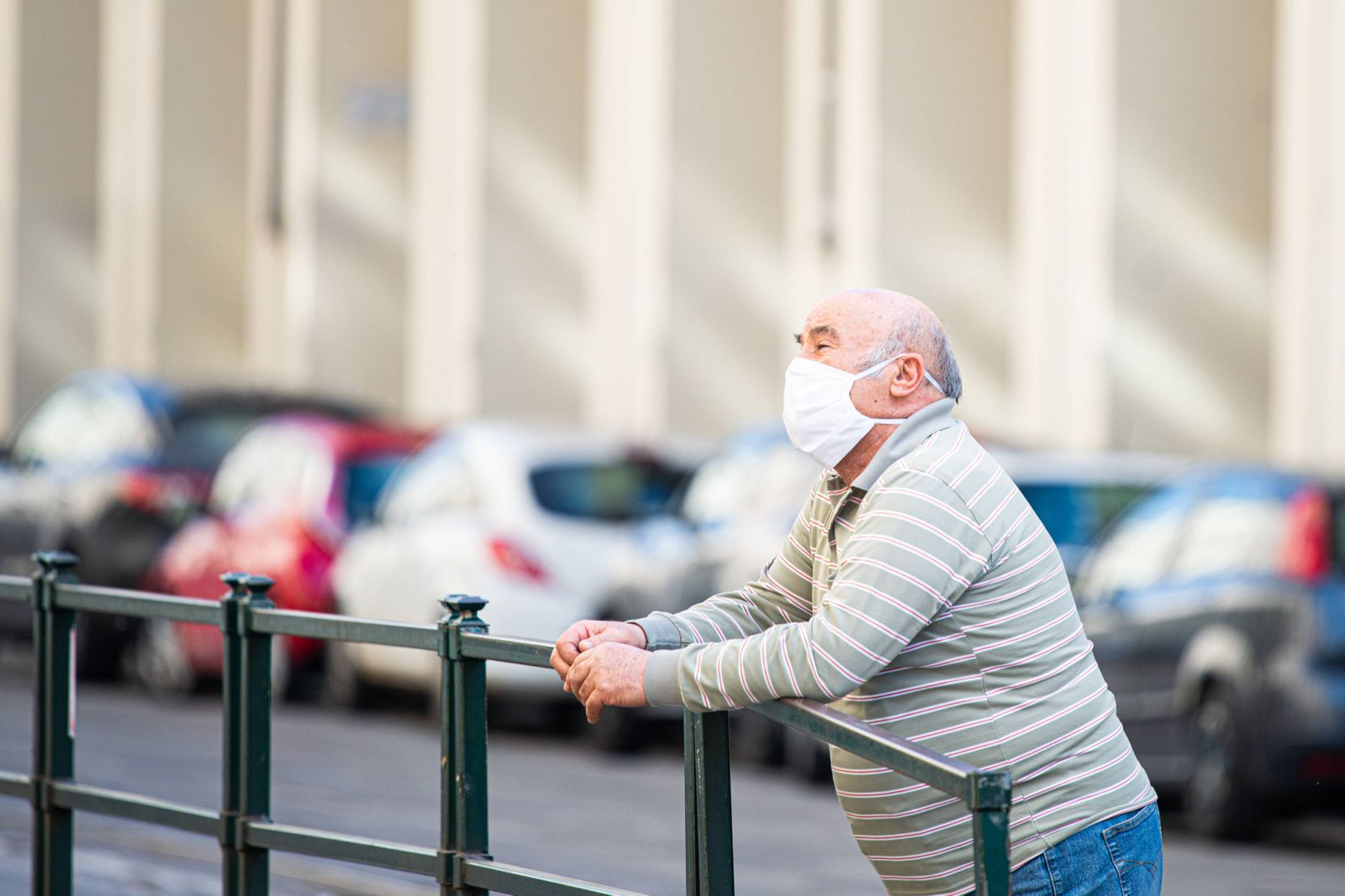 Italy: Turin lockdown 14th April 2020 People wear a safety mask in Piazza Castello in a deserted Turin on April 14, 2020