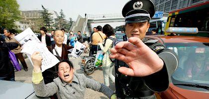 Chinas Umgang mit Presse und Protest bisher: Abwehr