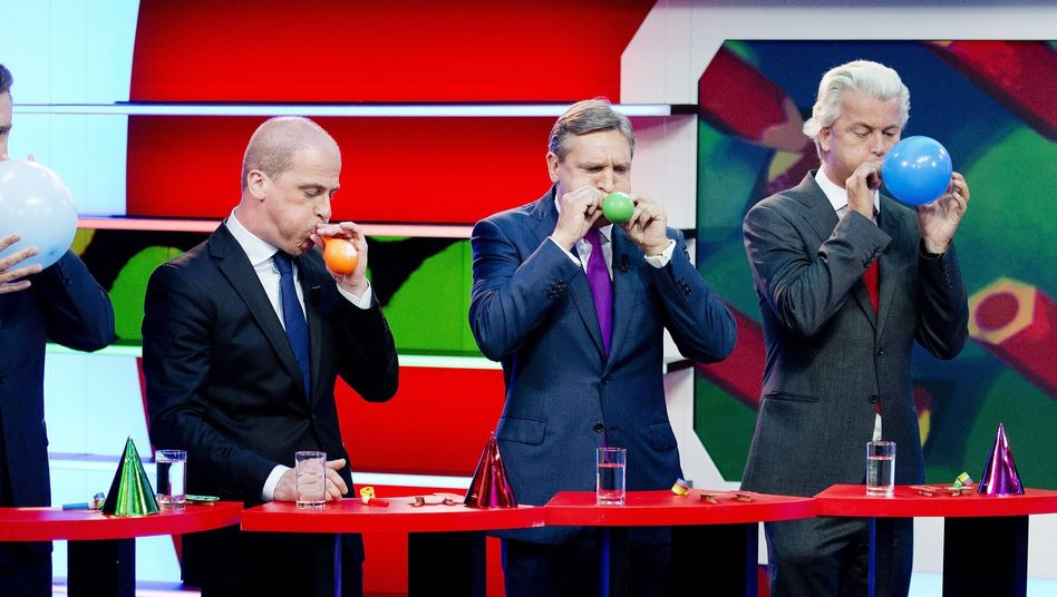 Leading candidates (from left to right) Diederik Samsom, Sybrand Haersma van Buma, Geert Wilders and Mark Rutte compete in a balloon-blowing contest for a children's show.