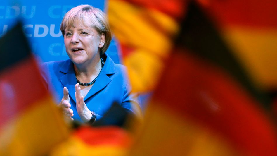 A happy Angela Merkel after hearing the first exit poll results.