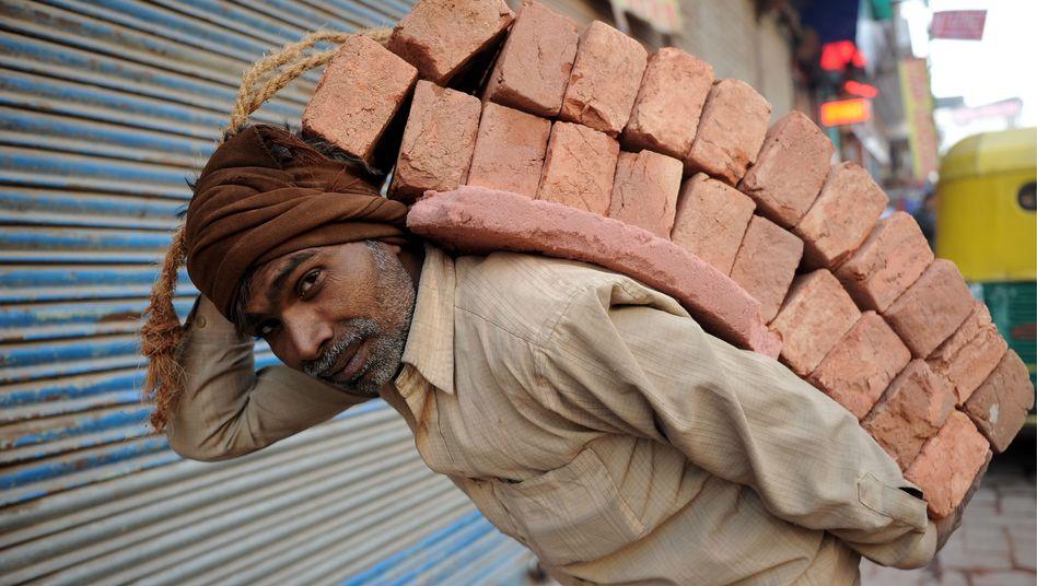 Arbeiter in Neu Delhi: Wachstum als Menschenrecht?
